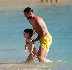 Charlie Austin and wife Bianca Parker spotted on a beach in Barbados. 23 May 2018 Pictured: Charlie Austin and wife Bianca Parker. Photo credit: Tonia Atwell/246paps / MEGA TheMegaAgency.com +1 888 505 6342