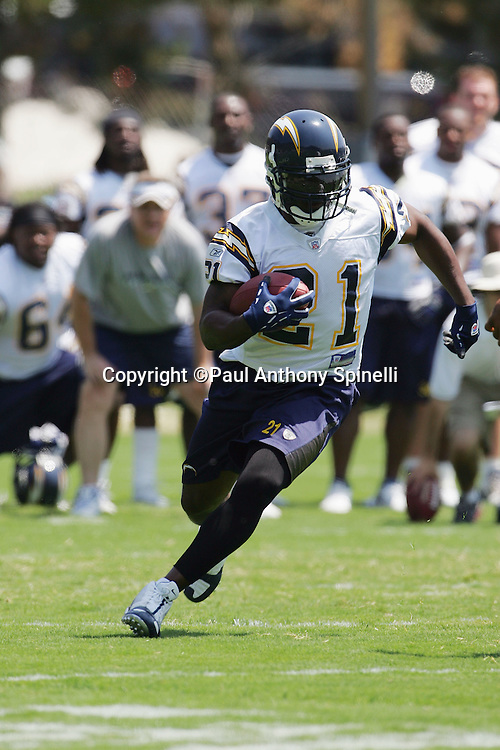 SAN DIEGO - JUNE 10:  Running back LaDainian Tomlinson #21 of the San Diego Chargers works out during mini camp drills at Chargers Park on June 10, 2006 in San Diego, California. ©Paul Anthony Spinelli *** Local Caption *** LaDainian Tomlinson