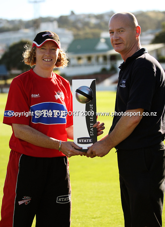 State cricket ambassador for the Wellington region Comal McKone presents Canterbury captain Haidee Tiffen with the State League trophy.<br /> State League final. Wellington Blaze v Canterbury Magicians at Allied Prime Basin Reserve, Wellington. Saturday, 24 January 2009. Photo: Dave Lintott/PHOTOSPORT