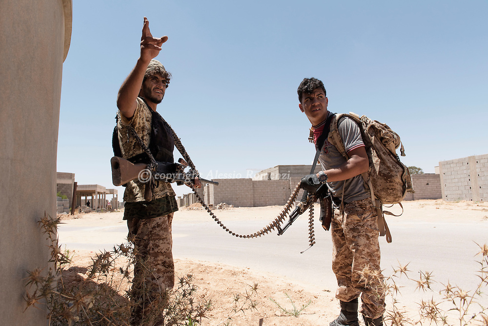 Libya: Libya's Government of National Accord's (GNA) fighters gesture to their comrades in 700 neighbourhood in Sirte. Alessio Romenzi