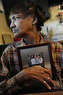 Sandy Drain pauses while talking about the disappearance of her niece Gloria Walker, pictured in frame, at her home in Cleveland on Wednesday November 4, 2009. Walker has been missing since May 20, 2007...