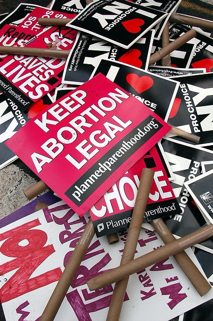 Protest signs lay on the side walk after a planned parenthood march in NYC on Aug. 28, 2004.Sandy Schaeffer/MAI/Landov