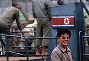 A North Korean man arrives in theYalu River border town of Sunuiju by boat Ocotber 10, 2006. North Korea's nuclear weapons are not yet developed or sophisticated enough to put on a missile, and military pre-emption isn't a viable strategy. Any attack aimed at destroying Kim's weapons would likely unleash North Korea's million-man army, poised just miles from the South Korean capital and the 28,000 U.S. troops stationed nearby... DPRK, north korea, china, dandong, border, liaoning, democratic, people's, rebiblic, of, korea, nuclear, test, rice, japan, arms, race, weapons, stalinist, communist, kin jong il