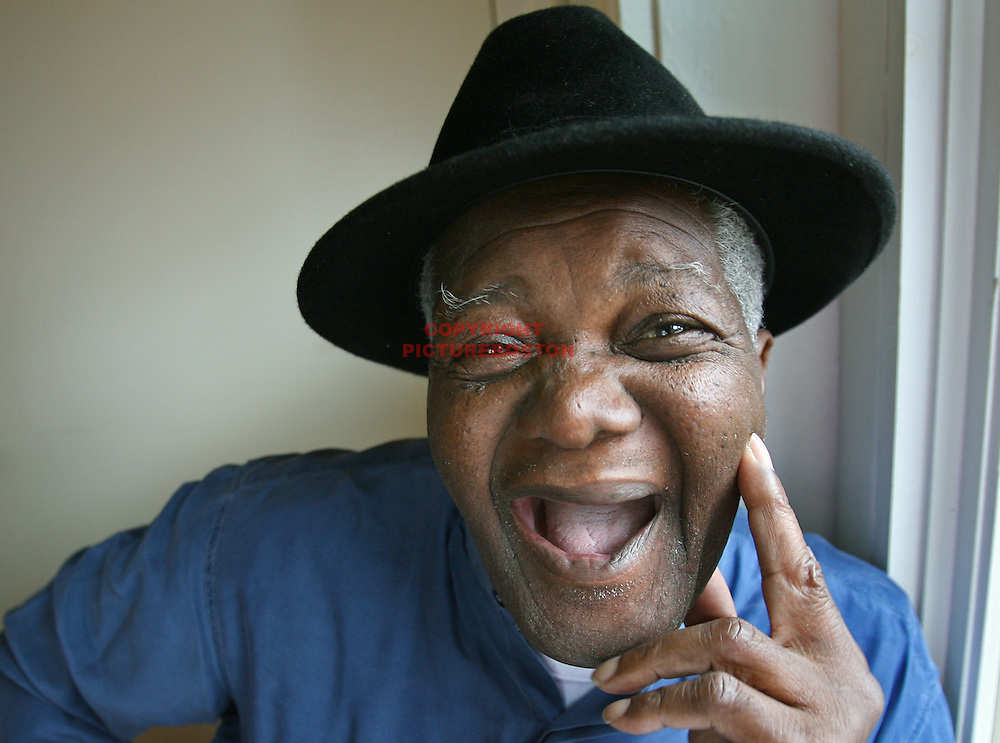 """(06/05/08-Boston,MA) Rudy """"Spider"""" Edwards relaxes in his Roxbury home. Spider was the long time, fedora-wearing, parquet sweeper at Boston Celtic's games of the past. He is proud that they are now in the NBA Finals."""