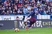 Elias Kachunga of Huddersfield Town (9) and Sead Kolasinac of Arsenal (31) go for the loose ball during the Premier League match between Huddersfield Town and Arsenal at the John Smiths Stadium, Huddersfield, England on 9 February 2019.