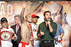 Nov 13, 2009; Las Vegas, NV, USA; Miguel Cotto waves to the fans during an interview with Jeremy Piven of HBO's Entourage at the MGM Grand Garden Arena in Las Vegas, Nevada.  Mandatory Credit: Ed Mulholland