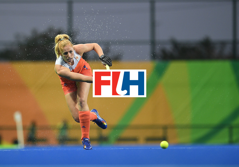 Netherland's Margot van Geffen hits the ball during the women's field hockey Netherlands vs South Korea match of the Rio 2016 Olympics Games at the Olympic Hockey Centre in Rio de Janeiro on August, 8 2016. / AFP / MANAN VATSYAYANA        (Photo credit should read MANAN VATSYAYANA/AFP/Getty Images)