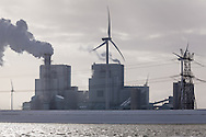 Wind turbines and the RWE Power Plant at dawn in Eemshaven, Netherlands