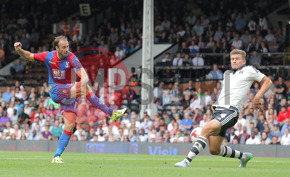 Glenn Murray of Crystal Palace has a shot on goal blocked by Shaun Hutchinson of Fulham - Mandatory by-line: Paul Terry/JMP - 07966386802 - 01/08/2015 - SPORT - FOOTBALL - Fulham,England - Craven Cottage - Fulham v Crystal Palace - Pre-Season Friendly