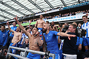 Brighton & Hove Albion winger Anthony Knockaert (11) and Brighton & Hove Albion full back Bruno Saltor (Captain) (2) singing in celebration after the EFL Sky Bet Championship match between Brighton and Hove Albion and Wigan Athletic at the American Express Community Stadium, Brighton and Hove, England on 17 April 2017.
