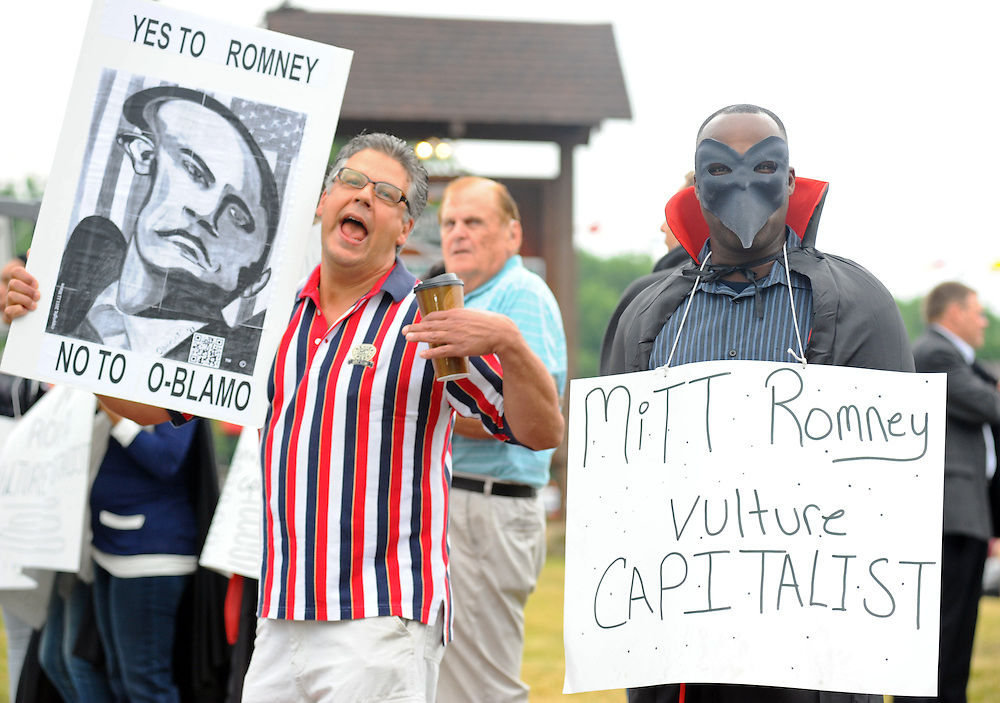 LAURA FONG | SUMMER KENT STATER Protesters on both sides of the political spectrum gathered outside Mapleside Farms in Brunswick. Mitt Romney made a campaign stop at Mapleside Farms in Brunswick, Ohio where he hosted a Father's Day pancake breakfast for about 3,500 people.