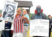 LAURA FONG   SUMMER KENT STATER Protesters on both sides of the political spectrum gathered outside Mapleside Farms in Brunswick. Mitt Romney made a campaign stop at Mapleside Farms in Brunswick, Ohio where he hosted a Father's Day pancake breakfast for about 3,500 people.