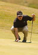 Korey Mahoney of East Lansing lines up his long birdie putt on the par 3, 17th of Boyne Mountains Alpine course during the final round of the 2007 Boyne Tournament of Champions.