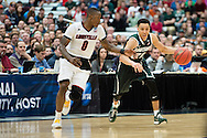 29 MAR 2015: Travis Trice (20) of Michigan State University dribbles downcourt againts Terry Rozier (0) of the University of Louisville during the 2015 NCAA Men's Basketball Tournament held at the Carrier Dome in Syracuse, NY. Michigan State defeated Louisville 76-70 to advance. Brett Wilhelm/NCAA Photos