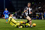 Grimsby Town goalkeeper James McKeown (1) fouls Notts County forward Jonathan Stead (30)  during the EFL Sky Bet League 2 match between Notts County and Grimsby Town FC at Meadow Lane, Nottingham, England on 16 December 2017. Photo by Simon Davies.