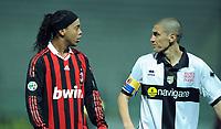 "RONALDINHO Milan e Giacomo MORRONE Parma.<br /> Parma, 24/03/2010 Stadio ""Tardini""<br /> Parma-Milan.<br /> Campionato Italiano Serie A 2009/2010<br /> Foto Nicolo' Zangirolami Insidefoto"