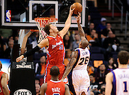 Dec. 23, 2012; Phoenix, AZ, USA; Los Angeles Clippers forward Blake Griffin (32) blocks the Phoenix Suns guard Shannon Brown (26) in the first half at US Airways Center. The Clippers defeated the Suns 103-77. Mandatory Credit: Jennifer Stewart-USA TODAY Sports..