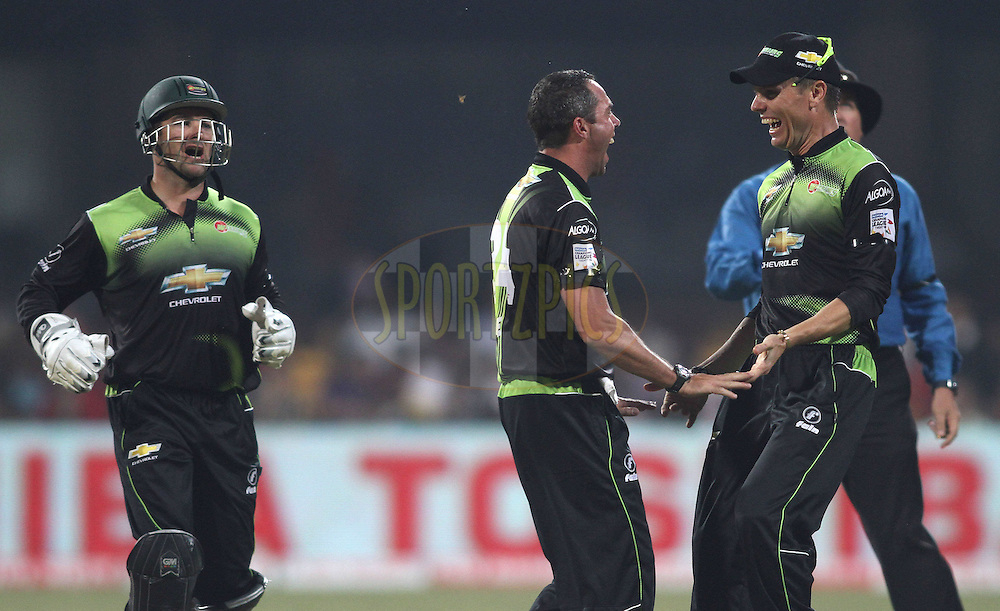 Nicky Boje of the Warriors celebrates a wicket with Johan Botha of the Warriors during match 1 of the NOKIA Champions League T20 ( CLT20 )between the Royal Challengers Bangalore and the Warriors held at the  M.Chinnaswamy Stadium in Bangalore , Karnataka, India on the 23rd September 2011..Photo by Shaun Roy/BCCI/SPORTZPICS