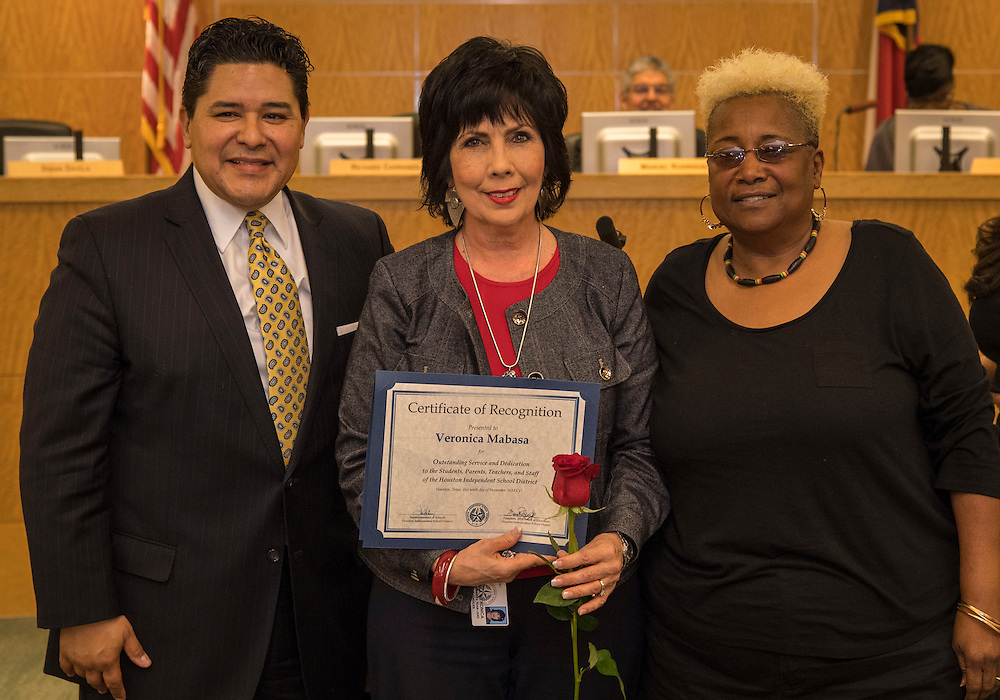 Superintendent Richard Carranza, left, and Wretha Thomas, right, recognize Veronica Mabasa, center, during the Houston ISD Board of Trustee meeting, November 10, 2016.