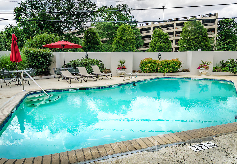 "A swimming pool is ready for the summer season at University Inn, a family-owned hotel located near Emory University in Atlanta, Georgia, May 29, 2014. The inn opened in January 1971 and offers 60 rooms to meet the lodging needs of University parents and other Atlanta visitors. It was featured on the Travel Channel's ""Hotel Impossible,"" May 26, 2014. (Photo by Carmen K. Sisson/Cloudybright)"