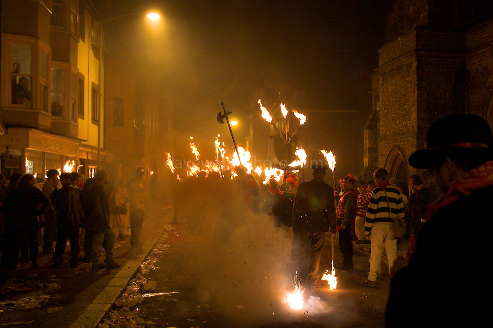 Torchlit procession by bonfire societies through the streets of Lewes