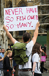 London, May 27th 2015. Protesters demonstrate against the Tories ongoing campaign of austerity on the day the Queen delivered her speech to Parliament