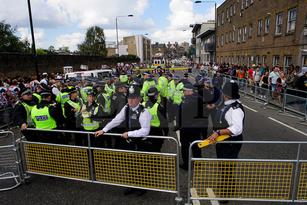 © Licensed to London News Pictures. 29/08/2016. London, UK. A large police presence at the entrance to carnival on Ladbroke Grove as arnival goers enjoy day two of the Notting Hill carnival, the second largest street festival in the world after the Rio Carnival in Brazil, attracting over 1 million people to the streets of West London.  Photo credit: Ben Cawthra/LNP