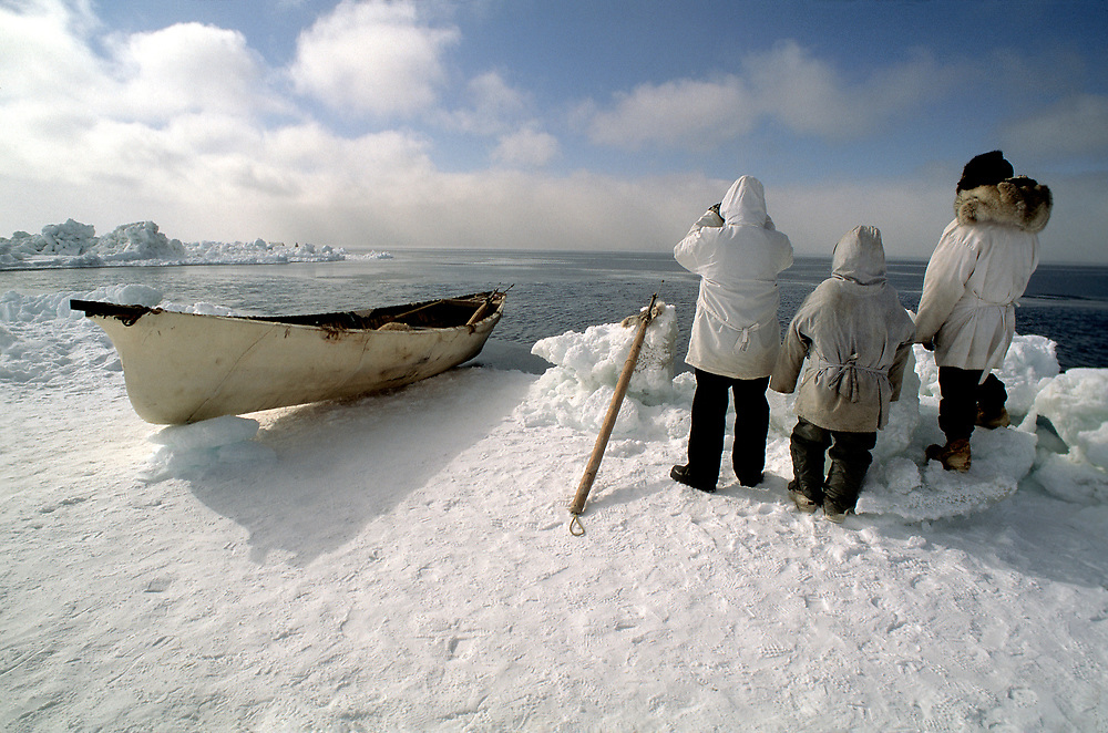 Barrow, Alaska, Native whaling crew watching for bowhead whales from the edge of the sea ice