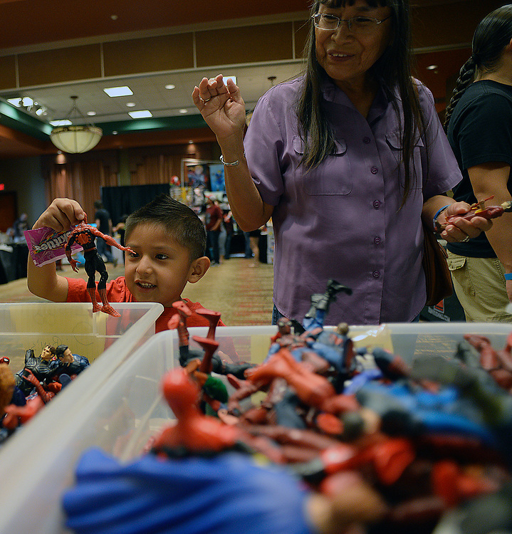 apl051417b/ASECTION/pierre-louis/JOURNAL 051417<br /> 4year-old Jerome Bird,,of Isleta Pueblo ,  picks a Spiderman figure toy  while attending the Duke City Comic Con with his grandmother Ruth Abeita,    .Photographed on Sunday May 14 2017. .Adolphe Pierre-Louis/JOURNAL