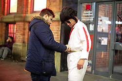 © Licensed to London News Pictures . 27/10/2018. Manchester, UK. A man adjusts Elvis Presley's cummerbund . Revellers on a night out , many in fancy dress , on the weekend before Halloween . Photo credit: Joel Goodman/LNP