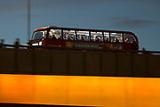 Blurred rush-hour commuters and a London bus cross London Bridge after the beginning of winter time, on 29th October 2018, in London, England.