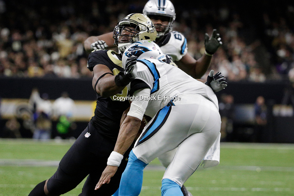 Jan 7, 2018; New Orleans, LA, USA; New Orleans Saints defensive tackle David Onyemata (93) hits Carolina Panthers quarterback Cam Newton (1) during the fourth quarter in the NFC Wild Card playoff football game at Mercedes-Benz Superdome. Mandatory Credit: Derick E. Hingle-USA TODAY Sports