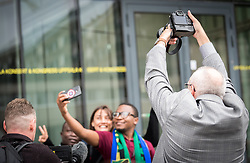 31 October 2018, Uppsala, Sweden: ACT Alliance head of communication Simon Chamberg takes photos of a group of ACT 2018 assembly participants as they take a group selfie.