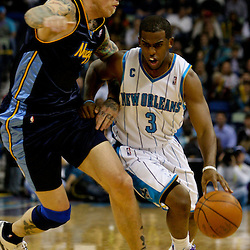 Dec 18, 2009; New Orleans, LA, USA;  New Orleans Hornets guard Chris Paul (3) drives in against Denver Nuggets center Chris Andersen (11) during the first quarter at the New Orleans Arena. Mandatory Credit: Derick E. Hingle-US PRESSWIRE