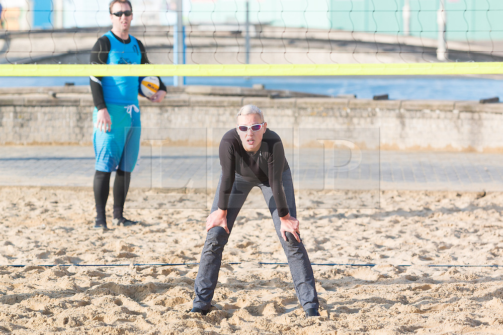© Licensed to London News Pictures. 28/12/2015. Brighton, UK. Members of the Brighton beach volleyball club play a game in the sunshine as the weather turns increasingly warmer. Today December 28th 2015. Photo credit: Hugo Michiels/LNP