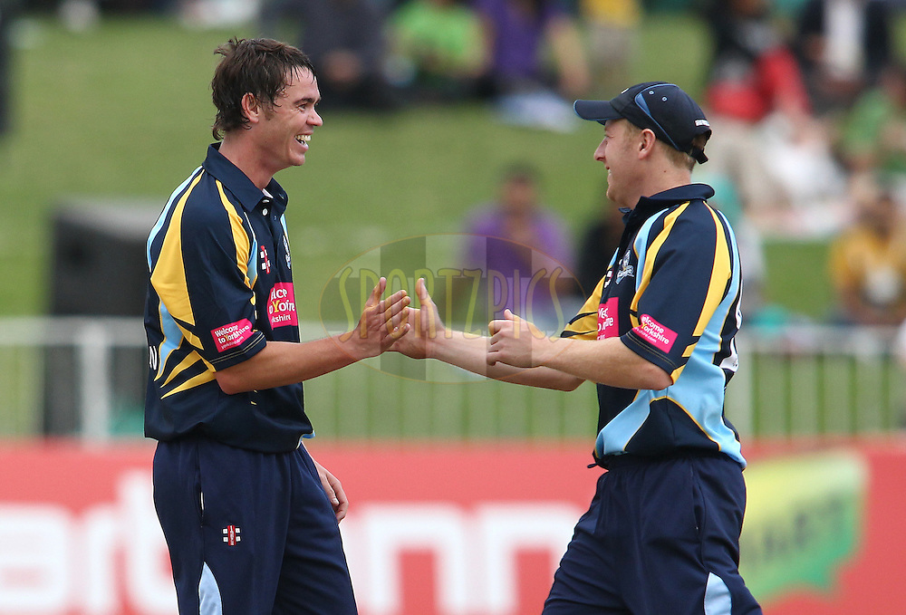 Iain Wardlaw of Yorkshire Carnegie is congratulated by Yorkshire Carnegie captain Andrew Gale for getting Chennai Super Kings captain MS Dhoni wicket during match 17 of the Karbonn Smart CLT20 South Africa between The Chennai Superkings and Yorkshire held at Kingsmead Park in Durban, South Africa on the 22nd October 2012..Photo by Shaun Roy/SPORTZPICS/CLT20