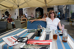 Tourist in cafe, Kotor, Montenegro, July 2018. MR