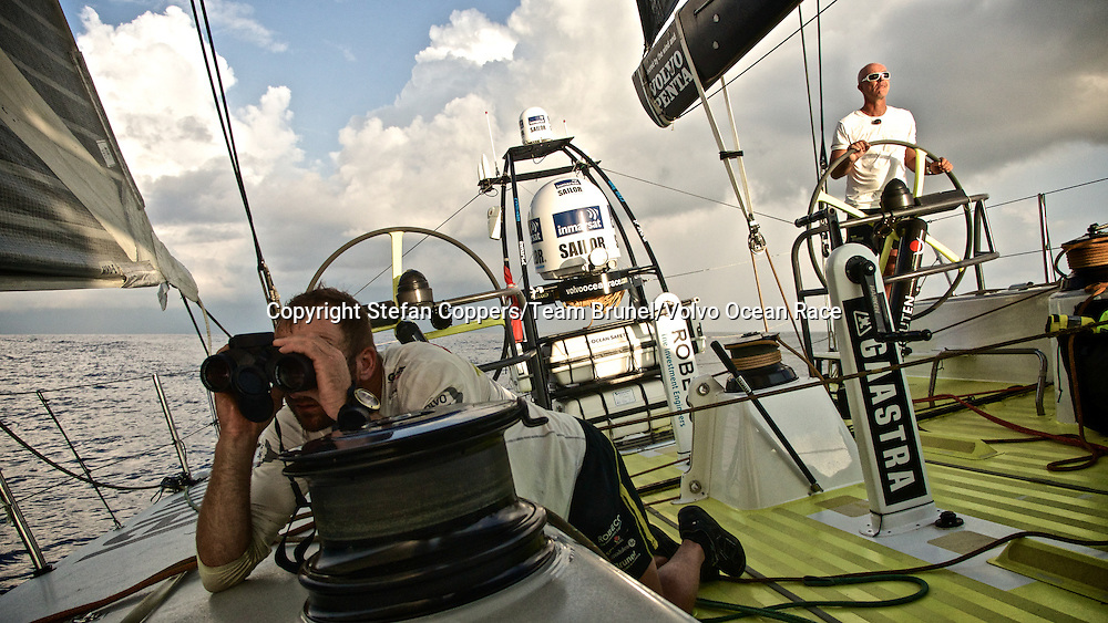 January 17, 2015. Day 14 of Leg 3 to Sanya, onboard Team Brunel. Jens Dolmer observes the other boats that sail just a few miles either side of them.