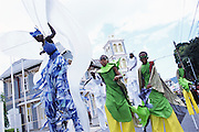 "Trinidad and Tobago ""MOKO JUMBIES: The Dancing Spirits of Trinidad"".(The energy is palpable as Jumbie Bat John Sterling and Bamboo Bug Men Moko Jumbies dance down Frederick Street in Port of Spain.).A photo essay about a stilt walking school in Cocorite, Trinidad..Dragon Glen de Souza founded the Keylemanjahro School of Art & Culture in 1986. The main purpose of the school is to keep children off the streets and away from drugs..He first taught dances like the Calypso, African dance and the jig with his former partner Cathy Ann Samuel.  Searching for other activities to engage the children in, he rediscovered the art of stilt-walking, a tradition known in West Africa as the Moko Jumbies , protectors of the villages and participants in religious ceremonies. The art was brought to Trinidad by the slave trade and soon forgotten..Today Dragon's school has over 100 members from age 4 and up..His 2 year old son Mutawakkil is probably the youngest Moko Jumbie ever. The stilts are made by Dragon and his students and can be as high as 12-15 feet. The children show their artistic talents mostly at the annual Carnival, which today is unthinkable without the presence of the Moko Jumbies. A band can have up to 80 children on stilts and they have won many of the prestigious prizes and trophies that are awarded by the National Carnival Commission. Designers like  Peter Minshall , Brian Mac Farlane and Laura Anderson Barbata create dazzling costumes for the school which are admired by thousands of  spectators. Besides stilt-walking the children learn the limbo dance, drumming, fire blowing and how to ride  unicycles..The school is situated in Cocorite, a suburb of Port of Spain, the capital of Trinidad and Tobago..all images © Stefan Falke"