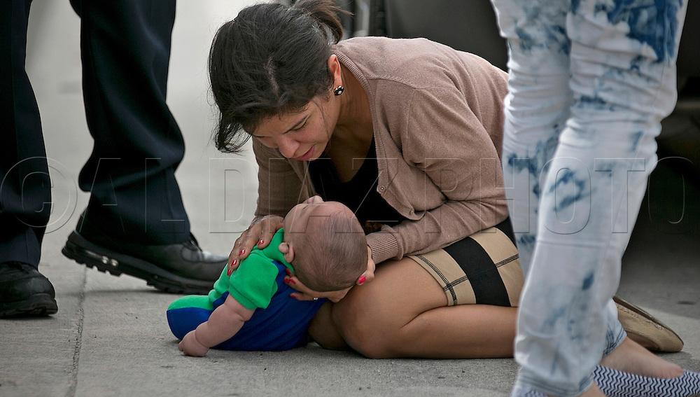 Pamela Rauseo, 37, checks on her nephew after performing CPR on the side of the road on five-month-old Sebastian de la Cruz. The baby stopped breathing twice during the dramatic rescue along Florida State Road 836 on Thursday, February 20, 2014.
