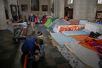 Afghan asylum seekers occupy the 'Saint-Jean-Baptiste' church in Brussels, Belgium, 7 December 2013. Belgian lawyer Salma Benkhelifa, started a hunger strike to show her support to Afghans asylum seekers, who are asking the Belgian authorities for residency permits.