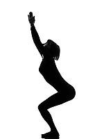 woman utkatasana chair position yoga pose posture position in silouhette on studio white background full length