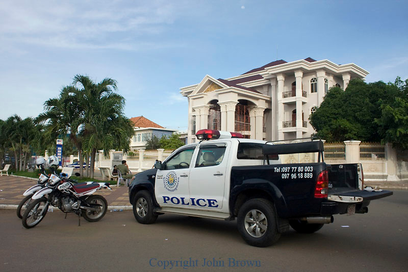 Police vehicles are parked near a newly constructed mansion belonging to Cambodian Prime Minister Hun Sen's brother, former Kompong Cham provincial governor Hun Neng, in Kampong Cham, Cambodia.