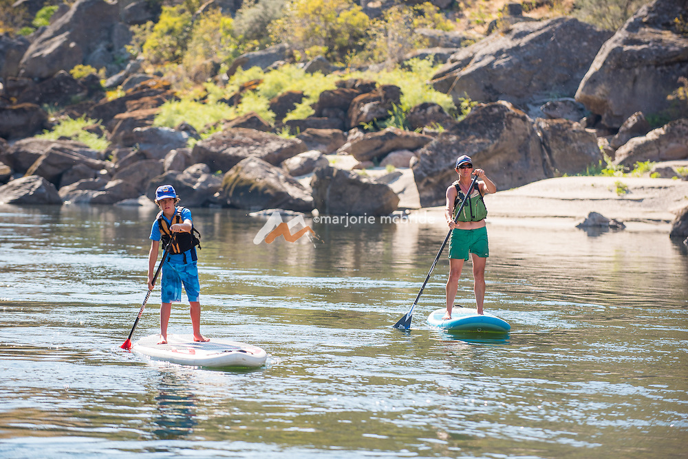 Mother and son paddle boarding while rafting the Main Lower Salmon River, Hammer Creek to Hellar Bar, Idaho. MR
