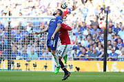 Chelsea Oliver Giroud heads the ball battling with Manchester United Defender Chris Smalling during the FA Cup Final between Chelsea and Manchester United at Wembley Stadium, London, England on 19 May 2018. Picture by Phil Duncan.