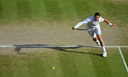 LONDON, ENGLAND - Friday, July 4, 2014: Milos Raonic (CAN) during the Gentlemen's Singles Semi-Final match on day eleven of the Wimbledon Lawn Tennis Championships at the All England Lawn Tennis and Croquet Club. (Pic by David Rawcliffe/Propaganda)
