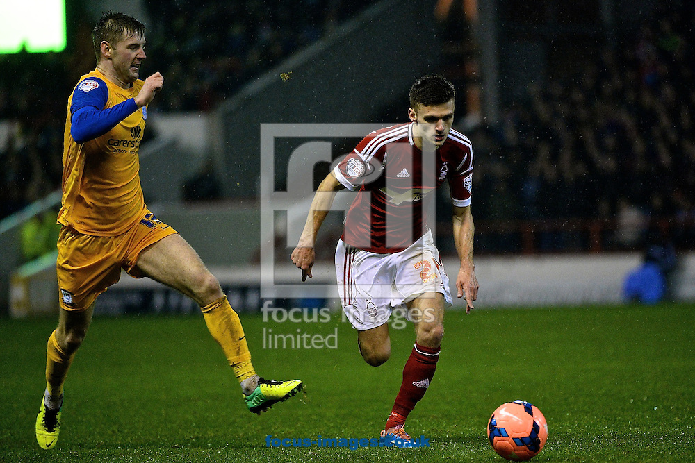 Picture by Ian Wadkins/Focus Images Ltd +44 7877 568959<br /> 24/01/2014<br /> Jamie Paterson of Nottingham Forest evades Joe Garner of Preston North End during the The FA Cup match at the City Ground, Nottingham.