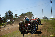 Rose Troth blocks out the dust during a tractor pull in Girard, Kansas, Sep. 6, 2010.