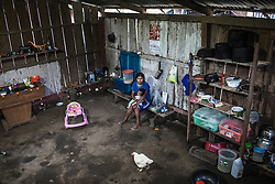 Early morning in Unido Mantaro. Susan Sanchez Diaz, 23 years old, with her daughter in the lap. The latest statistics from UNICEF showed that 92 percent of Vraes inhabitants lived below the poverty line and nearly 47 percent lived in extreme poverty.