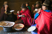 In the afternoon, after the women work in the fields, Ermelinda Ayme's sisters often come to visit her at her home in the village of Tingo, central Andes, Ecuador. (From the book Hungry Planet; What the World Eats. Ermelinda Ayme is also one of the 80 people featured with one day's food in the book What I Eat: Around the World in 80 Diets.)  The women gossip, and nurse their babies, snacking on small potatoes and corn that has been parched and roasted. Hungry Planet: What the World Eats (p. 115).  The Ayme family of Tingo, Ecuador, a village in the central Andes, is one of the thirty families featured, with a weeks' worth of food, in the book Hungry Planet: What the World Eats. The family consists of Ermelinda Ayme Sichigalo, 37, Orlando Ayme, 35, and their children: Livia, 15, Moises, 11, Jessica, 10, Natalie, 8, Alvarito, 4, Mauricio, 30 months, and Orlando hijo (Junior), 9 months. Lucia, 5, lives with her grandparents to help them out. (Please refer to Hungry Planet book p. 106-107 for a family portrait [Image number ECU04.0001.xxf1rw] including a weeks' worth of food, and the family's detailed food list with total cost.)